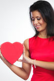 Lovely woman with red heart shaped gift box Stock Photo