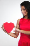 Lovely woman with red heart shaped gift box Royalty Free Stock Image