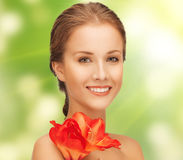 Lovely woman with red lily flower Stock Image