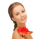 Lovely woman with red lily flower Royalty Free Stock Image
