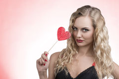 Lovely woman with red lollipop Stock Photos