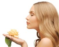 Lovely woman with rose flower Royalty Free Stock Photo