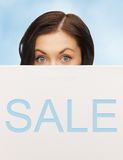 Lovely woman with sale billboard Stock Image