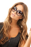 Lovely woman in shades. Bright picture of lovely woman in shades Royalty Free Stock Photography