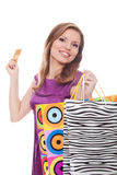 Lovely woman with shopping bags and credit card Royalty Free Stock Images