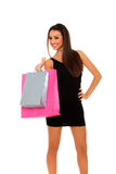 Lovely woman with shopping bags over white Stock Images