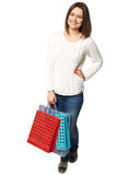 Lovely woman with shopping bags over white Stock Photos