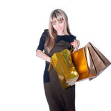 Lovely woman with shopping bags over white Royalty Free Stock Images