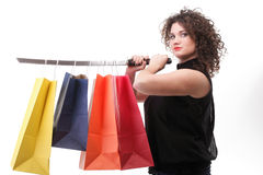 Lovely woman with shopping bags and sword Stock Photos