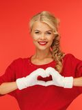 Lovely woman showing heart shape Royalty Free Stock Image