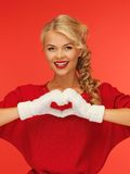 Lovely woman showing heart shape Stock Photography