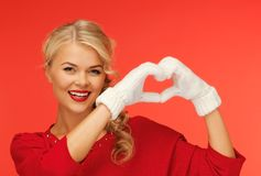 Lovely woman showing heart shape Royalty Free Stock Photos