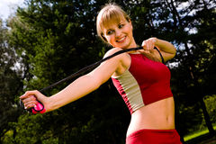 Lovely woman with a skipping rope Royalty Free Stock Image