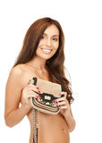 Lovely woman with small handbag Royalty Free Stock Photo