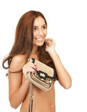 Lovely woman with small handbag Royalty Free Stock Images