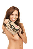Lovely woman with small handbag Royalty Free Stock Photography