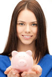 Lovely woman with small piggy bank Stock Photography