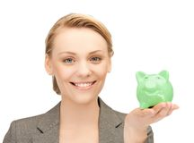 Lovely woman with small piggy bank Royalty Free Stock Photo