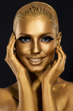 Coloring & Glance. Gorgeous Woman smiling. Fantastic Golden Makeup. Art Royalty Free Stock Photography