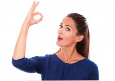 Lovely woman smiling and making an ok sign Royalty Free Stock Images