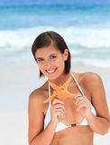 Lovely woman with a starfish Royalty Free Stock Photography