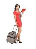 Lovely woman with suitcase and book Royalty Free Stock Image