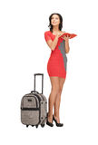 Lovely woman with suitcase and book Royalty Free Stock Photography