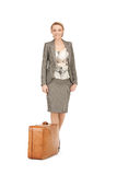 Lovely woman with suitcase Stock Images