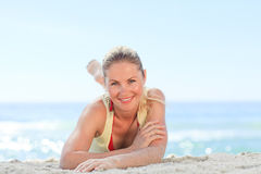 Lovely woman sunbathing at the beach Stock Images
