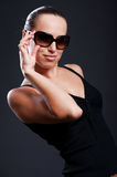 Lovely woman in sunglasses Stock Images