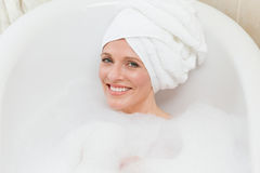 Lovely woman taking a bath Stock Photo