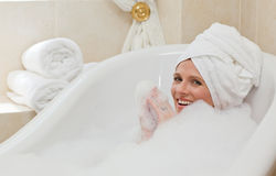 Lovely woman taking a bubble bath Stock Image