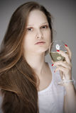 Lovely woman tasting white wine Stock Photo