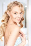 Lovely woman in towel Stock Photos