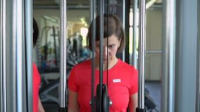 The lovely woman trains in the fitness studio. Sports training stock video footage