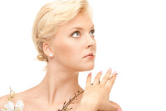 Lovely woman with twig Royalty Free Stock Image