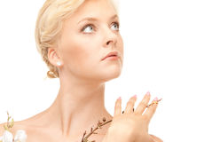 Lovely woman with twig Stock Photo