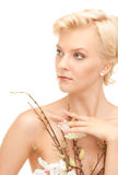 Lovely woman with twig Stock Images