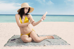 Lovely woman using sunscreen Royalty Free Stock Photography