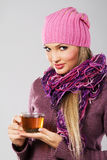 Lovely woman in warm clothing with cup of tea Stock Image