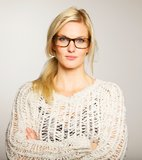 Lovely Woman Wearing Glasses Looking Serious Stock Photography