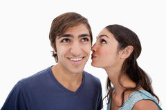 Lovely woman whispering something to her fiance Stock Photography