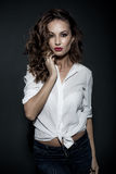 Lovely woman in white blouse Royalty Free Stock Photography
