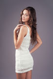 Lovely woman in white elegant dress Stock Photography
