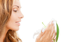 Lovely woman with white lily flower Stock Image