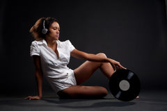 Lovely woman in white shirt with vinyl Royalty Free Stock Photography