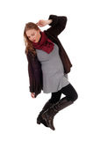Lovely woman in winter coat dancing. Royalty Free Stock Photo