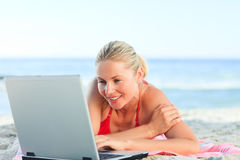 Lovely woman working on her laptop Stock Photo