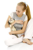 Lovely woman with young ferret. Stock Photos
