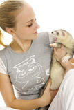 Lovely woman with young ferret. Royalty Free Stock Images